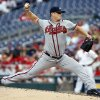 Photo - Atlanta Braves starting pitcher Gavin Floyd throws during the second inning of a baseball game against the Washington Nationals at Nationals Park Thursday, June 19, 2014, in Washington. (AP Photo/Alex Brandon)