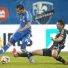 Photo - Montreal Impact's Andres Romero, left, and D.C. United's Perry Kitchen battle for the ball during the second half of a soccer game, Wednesday, June 11, 2014 in Montreal. (AP Photo/The Canadian Press, Graham Hughes)