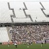 Corinthians\'s and Figueirense battle it out during a Brazilian soccer league match at the Itaquerao, the still unfinished stadium that will host the World Cup opener match between Brazil and Croatia on June 12, in Sao Paulo, Brazil, Sunday, May 18, 2014. Only 40,000 tickets were put on sale for Corinthians\' match against Figueirense because some of the 20,000 temporary seats needed for the World Cup opener are still being installed. (AP Photo/Andre Penner)