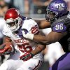 Oklahoma\'s Damien Williams (26) tries to get past TCU\'s Chucky Hunter (96) during a college football game between the University of Oklahoma Sooners (OU) and the Texas Christian University Horned Frogs (TCU) at Amon G. Carter Stadium in Fort Worth, Texas, Saturday, Dec. 1, 2012. Oklahoma won 24-17. Photo by Bryan Terry, The Oklahoman