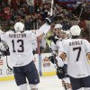 AHL HOCKEY: OKC\'s Curtis Hamilton (13) celebrates with his teammates after a goal during a game between the Oklahoma City Barons and the Houston Aeros at the Cox Convention Center in Oklahoma City, Saturday, Dec. 17, 2011. Photo by Garett Fisbeck, The Oklahoman ORG XMIT: KOD