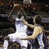 Charlotte Bobcats\' Michael Kidd-Gilchrist, left, shoots as Memphis Grizzlies\' Marc Gasol, right, of Spain, defends during the first half of an NBA basketball game, Saturday, Nov. 17, 2012, in Charlotte, N.C. (AP Photo/Chuck Burton)
