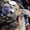 Ken Parker of Newport, Mich., shows off his collection of Detroit Tigers pins on his cap before the start of the baseball game against the Kansas City Royals in Detroit, Monday, March 31, 2014. (AP Photo/Carlos Osorio)