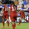 Photo - United States forward Sydney Leroux (2) celebrates with teammates midfielders Carli Lloyd (10) and Tobin Heath (17) after scoring against France during the first half of a women's friendly soccer match on Saturday, June 14, 2014, in Tampa, Fla. (AP Photo/Chris O'Meara)