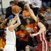 Oklahoma State\'s Liz Donohoe (4) shoots against Oklahoma\'s Nicole Kornet (1) during the Bedlam women\'s college basketball game between Oklahoma State University and the University of Oklahoma at Gallagher-Iba Arena in Stillwater, Okla., Saturday, Feb. 23, 2013. OSU beat OU, 83-62. Photo by Nate Billings, The Oklahoman