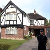 Photo -   Police on Thursday Sept. 6, 2012 stand outside the home of Saad al-Hilli in Claygate, Surrey, who has been named by French media as one of the members of a British family who was shot dead by a gunman in the French Alps. (AP Photo/Steve Parsons/PA) UNITED KINGDOM OUT NO SALES NO ARCHIVE