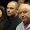 Olympic athlete Oscar Pistorius\' father Henke Pistorius, right, with his children Carl, center,, and Aimee, left, watch as Oscar Pistorius walks in during his bail hearing at the magistrate court in Pretoria, South Africa, Friday, Feb. 22, 2013. (AP Photo/Themba Hadebe)