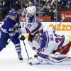 Toronto Maple Leafs\' Tyler Bozak, left, can\'t score past New York Rangers goalie Cam Talbot as Ryan McDonagh (27) defends during the second period of an NHL hockey game in Toronto, Saturday, Jan. 4, 2014. (AP Photo/The Canadian Press, Mark Blinch)