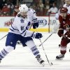 Photo - Toronto Maple Leafs right wing Phil Kessel (81) carries the puck past Phoenix Coyotes left wing Mikkel Boedker (89) in the first period of an NHL hockey game, Monday, Jan. 20, 2014, in Glendale, Ariz. (AP Photo/Rick Scuteri)