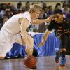 Douglass Stephen Clark tries to steal the ball from Roland\'s Brooks Robinson during the 4a boys championship game where the Douglass high school Trojans play the Roland Rangers at the State Fair Arena on Saturday, March 9, 2013 in Oklahoma City, Okla. Photo by Steve Sisney, The Oklahoman