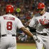 Los Angeles Angels\' Josh Hamilton, right, is greeted by Chris Nelson (8) after hitting a solo home-run against the Texas Rangers during the seventh inning of a baseball game, Wednesday, July 31, 2013, in Arlington, Texas. (AP Photo/Jim Cowsert)