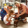 Angela Lester and her daughters Kourtney, 3, and Halie, 9, get acquainted with their newly adopted dachshund, which they named Justin. PHOTO BY LYNETTE LOBBAN, FOR THE OKLAHOMAN