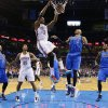 Oklahoma City\'s Kevin Durant (35) dunks the ball over Dallas\' Shawn Marion (0) during the NBA basketball game between the Oklahoma City Thunder and the Dallas Mavericks at Chesapeake Energy Arena in Oklahoma City, Okla. on Wednesday, Nov. 6, 2013. Photo by Chris Landsberger, The Oklahoman