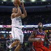 Photo - Boston Celtics guard Avery Bradley (0) goes up for a jumper against Washington Wizards forward Martell Webster (9) during the second half of an NBA basketball game in Boston, Wednesday, April 16, 2014. The Wizards won 118-102. (AP Photo/Elise Amendola)