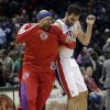 Photo - Detroit Pistons' Jose Calderon and Corey Maggette celebrate after an NBA basketball game against the Milwaukee Bucks on Saturday, Feb. 9, 2013, in Milwaukee. The Pistons won 105-100. (AP Photo/Morry Gash)