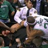 As a fight spills into the area behind the basket, Boston Celtics\' Rajon Rondo had his jersey pulled over his head as he and teammate Paul Pierce (34) battle Brooklyn Nets\' Kris Humphries, lower left, who struggles with security personnel at an NBA basketball game in Boston, Wednesday, Nov. 28, 2012. (AP Photo/The Globe/Jim Davis) NO SALES; MAGAZINES OUT; INTERNET OUT; BOSTON HERALD OUT; QUINCY OUT
