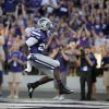 Photo - Kansas State running back Charles Jones celebrates in the end zone after scoring a touchdown during the first half of an NCAA college football game against Stephen F. Austin Saturday, Aug. 30, 2014, in Manhattan, Kan. (AP Photo/Charlie Riedel)