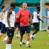 Photo - France's head coach Didier Deschamps, center, speaks with Rio Mavuba, center left, during an official training session the day before the group E World Cup soccer match between France and Switzerland at the Arena Fonte Nova stadium in Salvador, Brazil, Thursday, June 19, 2014. (AP Photo/David Vincent)