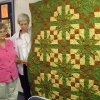 Olivia Voyles and Ruth Shaw, Harrah residents and members of the Harrah Historical Society, admire the Autumn Road to Harrah queen-sized quilt that is a fund-raiser for the society. The quilt may be seen at the Aug. 5 Rock Island Arts and Crafts Festival in Harrah at the Rock Island Depot, just east of Church Ave. and Main Street. Donations for the quilt will be used to help build the museum now in the planning stages. Community Photo By: Lin Archer Submitted By: Lin,
