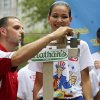 Sonya Thomas smiles as she stands on the scale during the official weigh-in for the Nathan\'s Fourth of July hot dog eating contest, Wednesday, July 3, 2013 at City Hall park in New York. (AP Photo/Mary Altaffer)