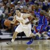 Photo - Texas' Javan Felix (3) drives the ball past Kansas' Elijah Johnson, right, during the first half of an NCAA college basketball game, Saturday, Jan. 19, 2013, in Austin, Texas. (AP Photo/Eric Gay)