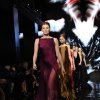 Photo - Model Karen Elson leads the finale for the Donna Karan New York Fall 2014 collection during Fashion Week,  Monday, Feb. 10, 2014, at 23 Wall Street in New York.  (AP Photo/Diane Bondareff)