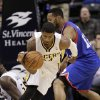 Photo - Indiana Pacers forward Paul George, left, steals the ball from Philadelphia 76ers forward Evan Turner during the second half of an NBA basketball game in Indianapolis, Saturday, Nov. 23, 2013. The Pacers won 106-98. (AP Photo/AJ Mast)
