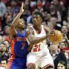 Chicago Bulls guard Jimmy Butler, right, looks to pass as Detroit Pistons guard Brandon Knight defends during the first half of an NBA basketball game in Chicago, Sunday, March 31, 2013. (AP Photo/Nam Y. Huh)