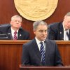 Photo - Alaska Gov. Sean Parnell delivers his State of the State address Wednesday, Jan. 22, 2014, at the state Capitol in Juneau, Alaska. Seated behind him are Senate President Charlie Huggins, R-Wasilla, left, and House Speaker Mike Chenault, R-Nikiski. Parnell used the address to lay out plans to change Alaska's education system, including improving access to charter schools and boosting public school funding. (AP Photo/Mark Thiessen)