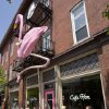 Photo - This undated photo provided by Visit Baltimore shows the giant pink flamingo outside Cafe Hon, an eatery along West 36th Street in the Hampden neighborhood of Baltimore. The neighborhood is known as a place where hipsters and kitsch Baltimore culture converge, and West 36th Street is lined with restaurants, vintage shops and antiques stores. (AP Photo/Visit Baltimore)
