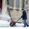 Dave Black uses a snow blower to clear snow from the sidewalks at St. Paul\'s Episcopal Church on First Street in Evansville, Ind., on Thursday, Dec. 27, 2012. (AP Photo/The Evansville Courier & Press, Erin McCracken)