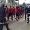 Photo - Detained fans of Chile's national soccer team, are marched away by security forces toward a holding area, after they broke through a stadium security checkpoint, in Rio de Janeiro, Brazil, Wednesday June 18, 2014. Nearly 100 rampaging Chilean fans busted through the checkpoint at the Maracana stadium Wednesday, sprinting through a large media room and breaking down walls trying to find a way into the sold-out Spain vs. Chile World Cup match. (AP Photo/Jorge Sainz)