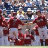 Photo - Arizona Diamondbacks' Cody Ross (7) and Ender Inciarte, left, are greeted by Gerardo Parra after scoring against the San Diego Padres during the fourth inning of a baseball game Sunday, May 4, 2014, in San Diego.  (AP Photo/Lenny Ignelzi)