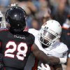 Oklahoma State\'s Joseph Randle (1) tries to get by Texas Tech\'s Happiness Osunde (28) during a college football game between Texas Tech University (TTU) and Oklahoma State University (OSU) at Jones AT&T Stadium in Lubbock, Texas, Saturday, Nov. 12, 2011. Photo by Sarah Phipps, The Oklahoman ORG XMIT: KOD