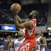 Houston Rockets guard James Harden, center, shoots between Sacramento Kings\' DeMarcus Cousins, left, and Tyreke Evans during the first quarter of an NBA basketball game in Sacramento, Calif., Wednesday, April 3, 2013. (AP Photo/Rich Pedroncelli)