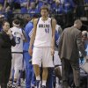 Dallas Mavericks power forward Dirk Nowitzki (41) of Germany walks out from the huddle in the final timeout of Game 4 in a first-round NBA basketball playoff series against the Oklahoma City Thunder, Saturday, May 5, 2012, in Dallas. The Thunder won 103-97. (AP Photo/LM Otero)