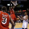 Miami\'s LeBron James (6) dunks the ball beside Oklahoma City\'s Thabo Sefolosha (2) during an NBA basketball game between the Oklahoma City Thunder and the Miami Heat at Chesapeake Energy Arena in Oklahoma City, Thursday, Feb. 15, 2013. Photo by Bryan Terry, The Oklahoman