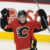 Photo - Calgary Flames' Sean Monahan celebrates scoring the go-ahead goal against the New Jersey Devils during the third period of an NHL hockey game Friday, Oct. 11, 2013, in Calgary, Alberta. The Flames won 3-2. (AP Photo/The Canadian Press, Larry MacDougal)