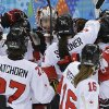 Photo - Goalkeeper Shannon Szabados of Canada is surrounded by teammates after Canada's 3-1 win over Switzerland in a 2014 Winter Olympics women's semifinal ice hockey game at Shayba Arena, Monday, Feb. 17, 2014, in Sochi, Russia. (AP Photo/Matt Slocum)