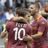 AS Roma forward Erik Lamela, of Argentina, center, celebrates with teammates Francesco Totti, back to camera, and Panagiotis Tachtsidis, of Greece, after scoring during a Serie A soccer match between AS Roma and Atalanta, at Rome\'s Olympic stadium, Sunday, Oct. 7, 2012. (AP Photo/Riccardo De Luca)