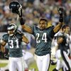 Philadelphia Eagles cornerbacks Nnamdi Asomugha (24) and Curtis Marsh (31) celebrate their 19-17 win over the New York Giants in an NFL football game, Sunday, Sept. 30, 2012, in Philadelphia. (AP Photo/The Express-Times, Matt Smith)