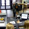 A robber points a weapon at tellers at a Bank of Oklahoma branch, 4324 SE 44, in Oklahoma City. PHOTOS PROVIDED