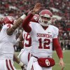Oklahoma\'s Landry Jones (12) and Kenny Stills (4) celebrate after Oklahoma scored a touchdown against Texas Tech during an NCAA college football game in Lubbock, Texas, Saturday, Oct. 6, 2012. (AP Photo/Lubbock Avalanche-Journal, Stephen Spillman) LOCAL TV OUT