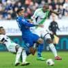 Photo - Hoffenheim's Roberto Firmino   center, challenges with  Wolfsburg's Luiz Gustavo, left, and Naldo, right, during the German Bundesliga  soccer match between TSG 1899 Hoffenheim and VfL Wolfsburg in Sinsheim, Germany,  Sunday March 2, 2014.  (AP Photo/dpa,Uwe Anspach)