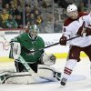 Photo - Phoenix Coyotes right wing Shane Doan (19) deflects the angle of a shot that Dallas Stars' Kari Lehtonen (32) stopped in the second period of an NHL hockey game, Saturday, Feb. 8, 2014, in Dallas. (AP Photo/Tony Gutierrez)