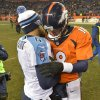 Photo - Denver Broncos quarterback Peyton Manning (18) and Tennessee Titans quarterback Ryan Fitzpatrick (4) talks following an NFL football game on Sunday, Dec. 8, 2013, in Denver. (AP Photo/Jack Dempsey)