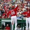 Photo - Washington Nationals' Jayson Werth (28) celebrates scoring with Ian Desmond (20), off a two-RBI double by Wilson Ramos, during the third inning of a baseball game against the New York Mets at Nationals Park Sunday, May 18, 2014, in Washington. (AP Photo/Alex Brandon)