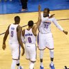 Oklahoma City\'s Russell Westbrook (0) celebrates his half court shot with Serge Ibaka (9) and Kevin Durant (35) during Game 3 of the Western Conference Finals in the NBA playoffs between the Oklahoma City Thunder and the San Antonio Spurs at Chesapeake Energy Arena in Oklahoma City, Sunday, May 25, 2014. Photo by Nate Billings, The Oklahoman