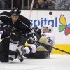 Photo - Los Angeles Kings defenseman Robyn Regehr, right, of Brazil, and Pittsburgh Penguins left wing Chris Kunitz collide during the first period of an NHL hockey game, Thursday, Jan. 30, 2014, in Los Angeles. (AP Photo)