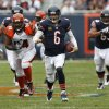 Photo - Chicago Bears quarterback Jay Cutler (6) rushes for yardage against the Cincinnati Bengals during the second half of an NFL football game, Sunday, Sept. 8, 2013, in Chicago. The Bears won 24-21. (AP Photo/Charles Rex Arbogast)